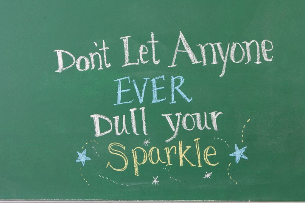 Inspirational Motivating phrase written on chalkboard of classroom